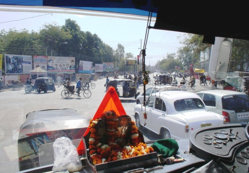 Riding in the front of the bus, shrine on the dashboard of a bus I rode from Delhi to Agra, India, 2005, photo © 2005-2009 by ybonsey, all rights reserved