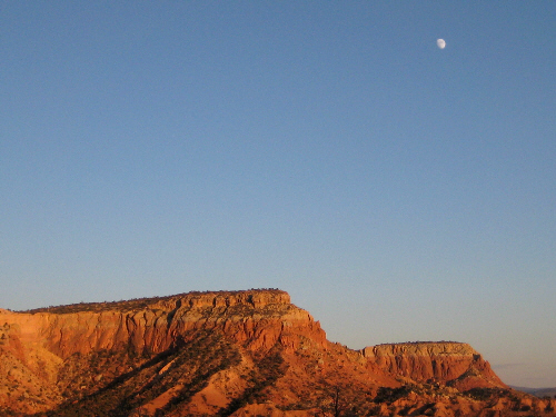 Moon over Kitchen Mesa, the moon at dusk at Ghost Ranch, August 1, 2009, photo © 2009 by ybonesy, all rights reserved